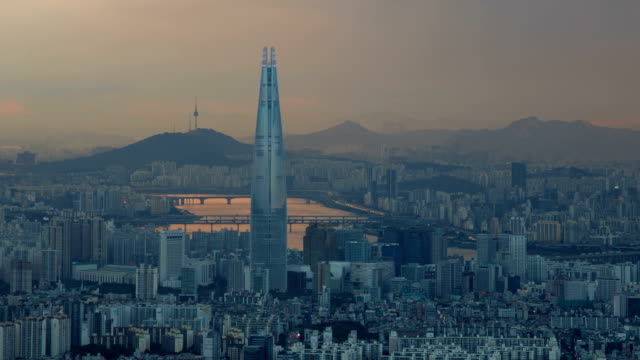 Day to night view of downtown district of Seoul and Lotte World Tower (the tallest building in Korea)