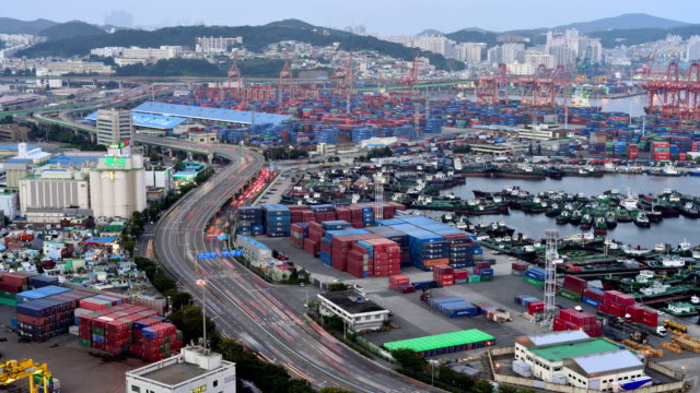 Day to night view of Hutchison Busan Container Terminal and Busan North Harbor (The largest port in South Korea)