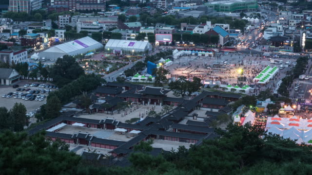 day to night view of hwaseong haenggung (one of the the largest temporary palace where the king and royal family retreated to during a war) - hwaseong palace stock videos and b-roll footage