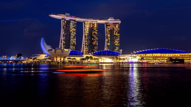 Day to night view of Marina Bay Sands Hotel