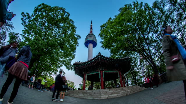 vídeos de stock, filmes e b-roll de day to night view of n seoul tower and palgakjeong gazebo - gazebo