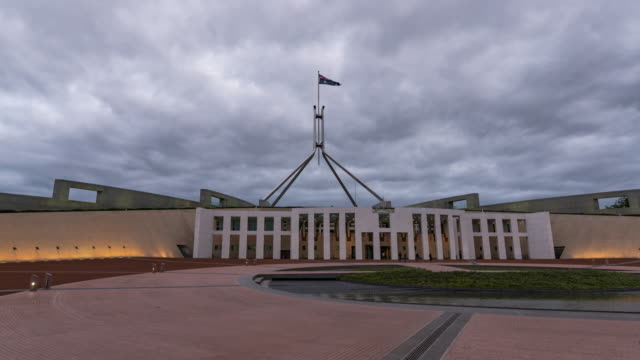 Day to night view of Parliament Square in Canberra, Australia