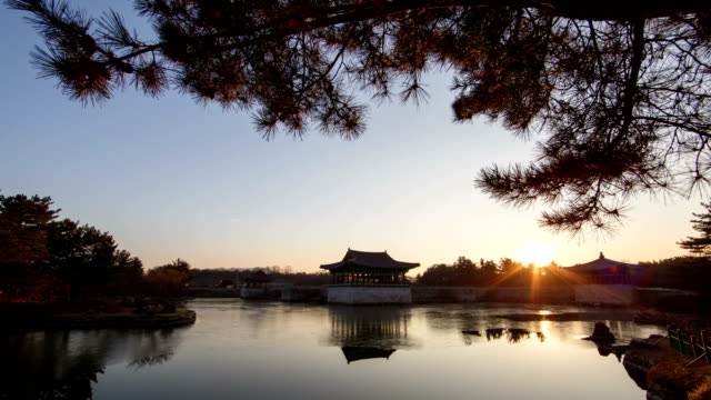 day to night view of pavilion and reflection of water surface at anapji pond(korea historic place 18) - pavilion video stock e b–roll
