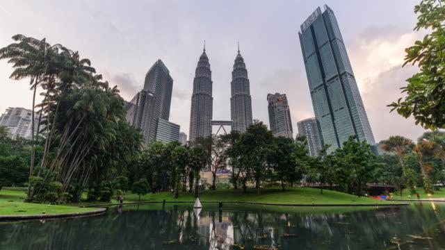 day to night view of petronas twin tower / kuala lumpur, malaysia - petronas twin towers stock videos & royalty-free footage