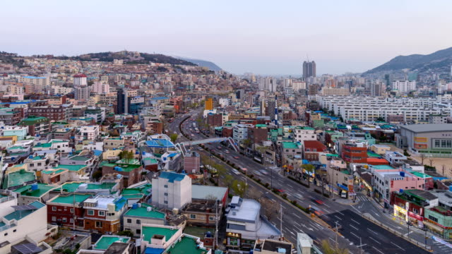 day to night view of seodaesin-dong and dongdaesin-dong with city buildings in busan - busan stock videos & royalty-free footage