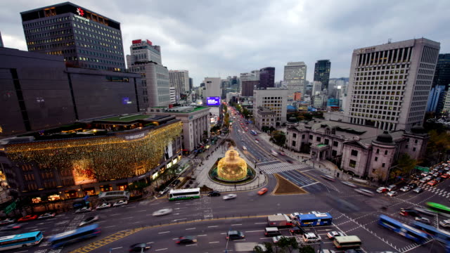 Day to night view of Shinsegae department store in Myeong Dong (Tourist most visited places and one of the primary shopping districts in Seoul) and a big christmas tree in winter