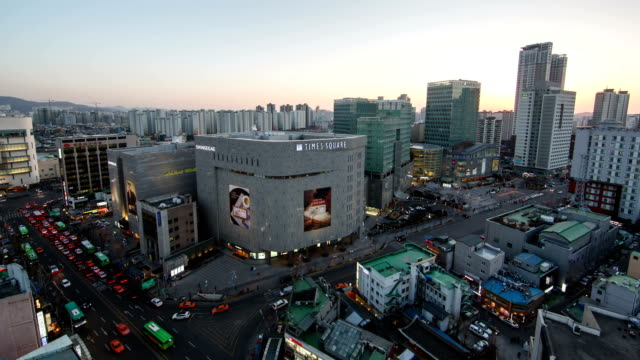 Day to night view of Shinsegae Department Store in Myeong Dong (Tourist most visited places and one of the primary shopping districts in Seoul)