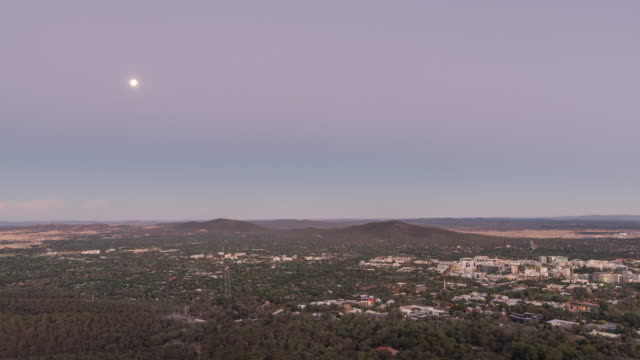day to night view of telstra tower and cityscape of canberra - day stock videos & royalty-free footage