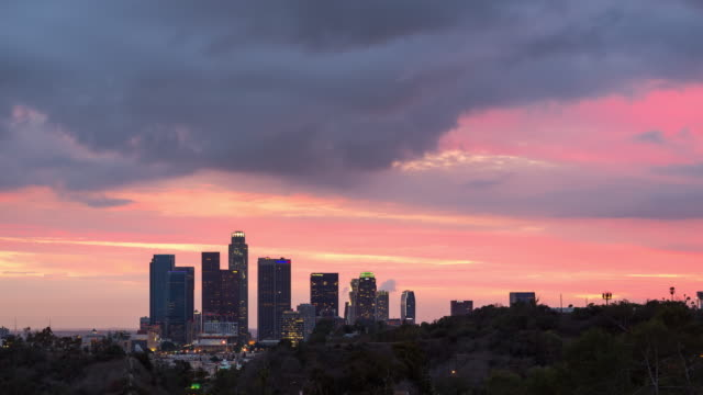 day to night view of the los angeles skyline with dramatic clouds - day to night time lapse stock videos & royalty-free footage