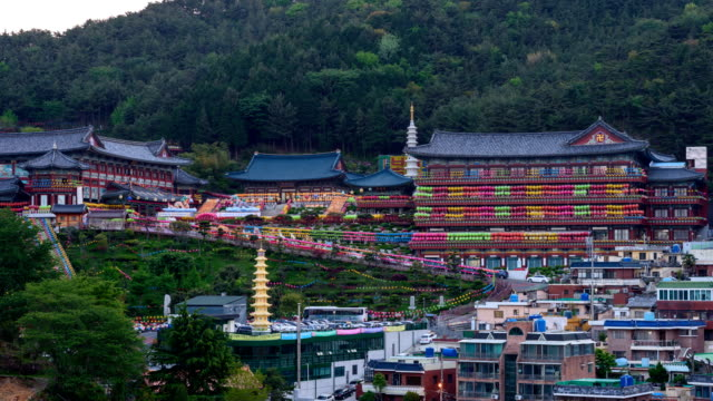 day to night view of yeondeunghoe festival (a lighting ceremony to celebrate buddha's birthday) at samkwangsa temple (largest buddhism temple in busan) - buddha's birthday stock videos and b-roll footage