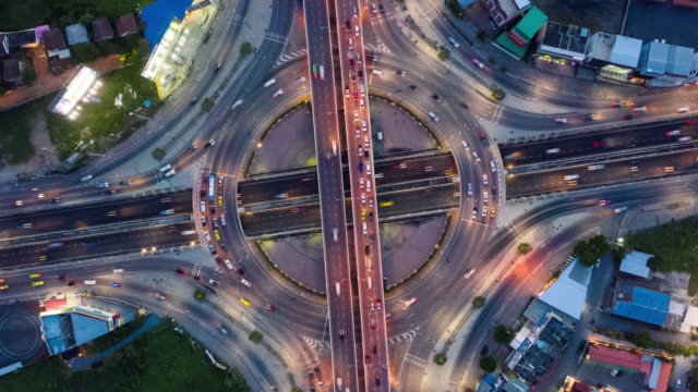 day to night zoom in : circle road traffic with zoom in - road junction stock videos & royalty-free footage