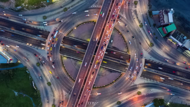 day to night zoom out : circle road traffic with zoom out - day to night time lapse stock videos & royalty-free footage