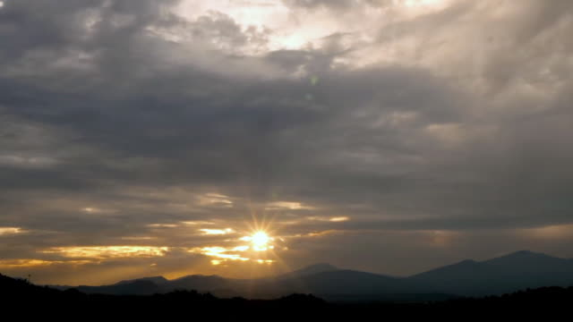 day to sunset time lapse of clouds moving over mountains - nigeria stock videos & royalty-free footage