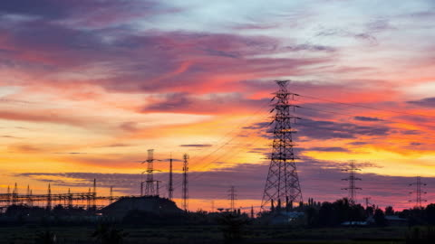 day to sunset timelapse of a high voltage electrical tower - high voltage sign stock videos & royalty-free footage
