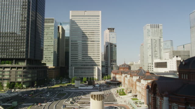 day view of office buildings front of tokyo station - marunouchi stock videos & royalty-free footage