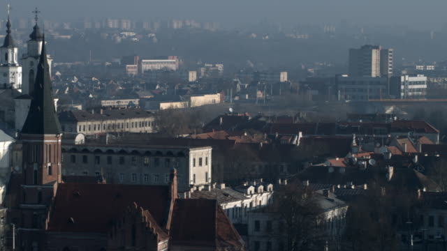 day view of st. francis xaview church and the surroundings city. moving shot across the city - lithuania stock videos & royalty-free footage