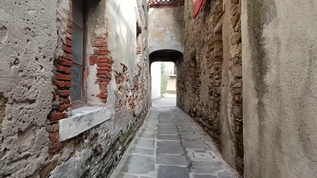day walking through empty charming narrow old rustic street of mediterranean town koper in slovenia, europe - slovenia stock videos & royalty-free footage