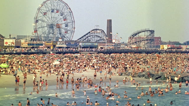 day wide angle of coney island beach; ferris wheel, roller coaster in bg. (period 1958) - 1958 stock videos & royalty-free footage