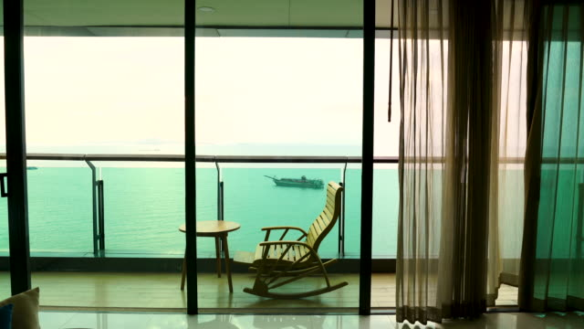 4k daybed and beach chair on the balcony - modern bedroom stock videos & royalty-free footage
