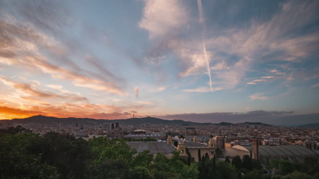 daybreak timelapse of barcelona city skyline. pink sunset.  spain, 2020. - barcelona spanien stock-videos und b-roll-filmmaterial