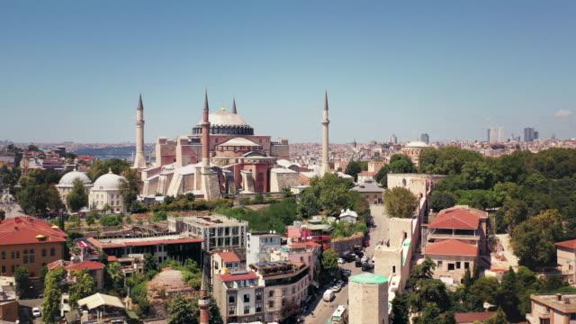 daylight drone video of hagia sophia in istanbul - モスク点の映像素材/bロール