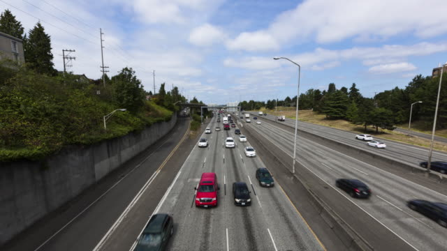 Daylight time lapse of a Seattle freeway with free flowing traffic