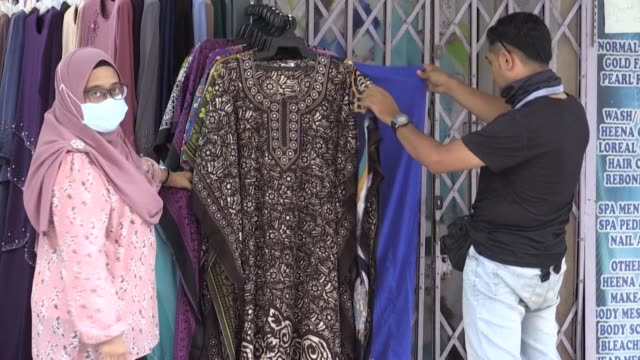 days ahead of eid, business is slow in kuala lumpur as normally crowded shops struggle to keep afloat. fears are rising among some shopkeepers they... - kuala lumpur stock videos & royalty-free footage