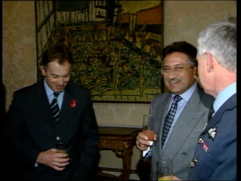 day's main events itn england london downing street number 10 int ms blair laughing with man pan pull out as musharraf chatting to man in military... - jack straw stock videos and b-roll footage