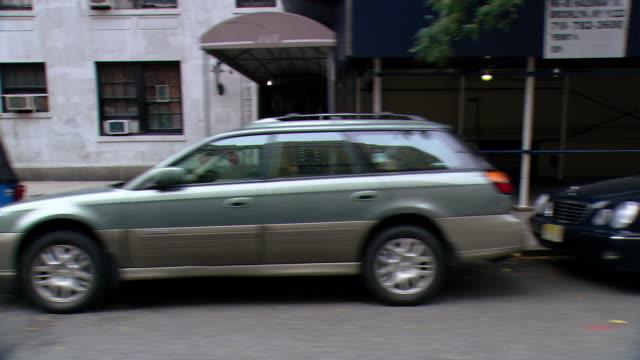CPOV / SIDE VIEW / Daytime Driving Through Manhattan / New York City / NY NY