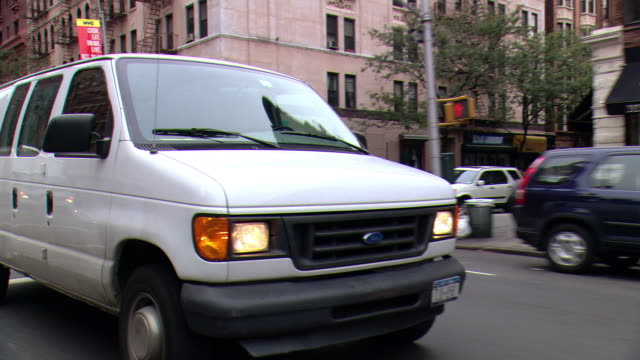 cpov / ts / side / rear view / daytime driving through manhattan / new york city / ny ny - van vehicle stock videos and b-roll footage