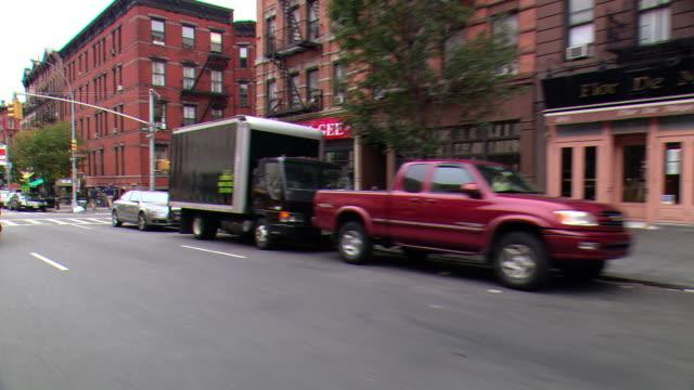 CPOV / TS / SIDE / REAR VIEW / Daytime Driving Through Manhattan / New York City / NY NY