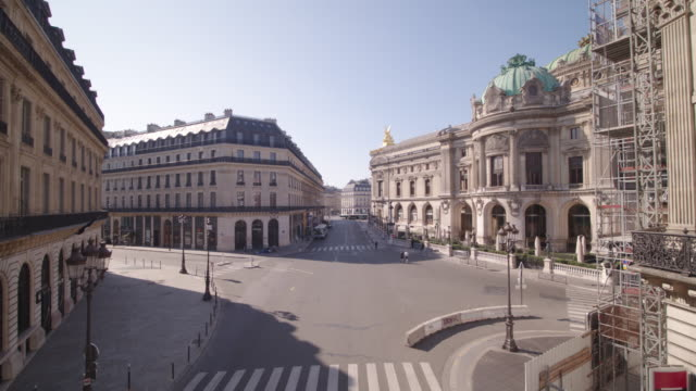 daytime drone flight along a deserted street rue halévy ending at palais garnier during the covid 19 shutdown/corona lockdown - international landmark stock videos & royalty-free footage
