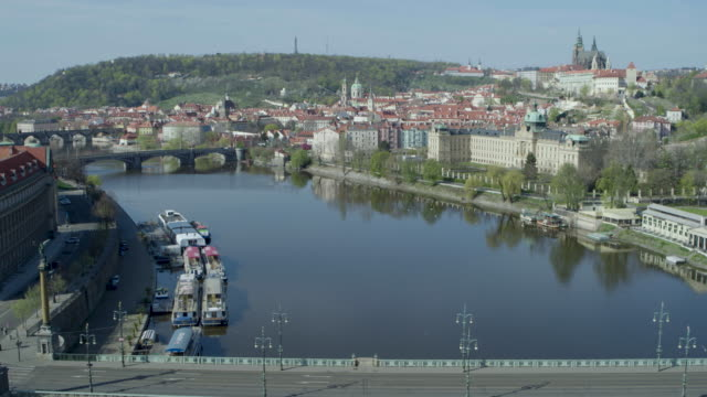 daytime drone flight of a deserted cech's bridge from the moldau river in prague, czech republic during the covid 19 shutdown/corona lockdown - czech republic stock videos & royalty-free footage
