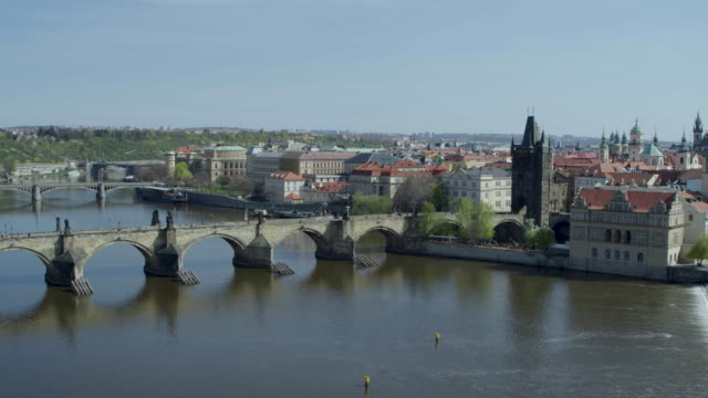 daytime drone flight of a deserted charles bridge from the moldau river in prague, czech republic during the covid 19 shutdown/corona lockdown - international landmark stock videos & royalty-free footage