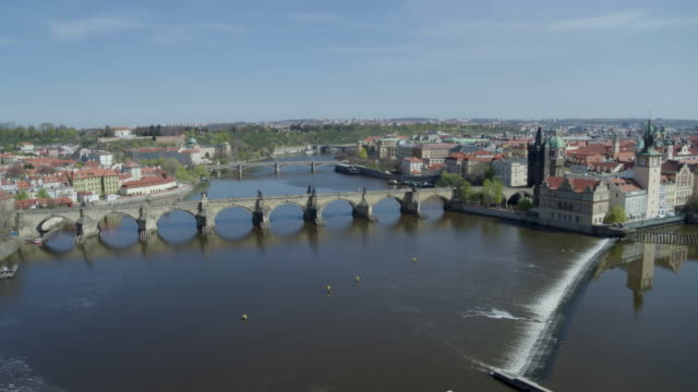 daytime drone flight of a deserted charles bridge from the moldau river in prague czech republic during the covid 19 shutdown/corona lockdown - charles bridge stock videos & royalty-free footage