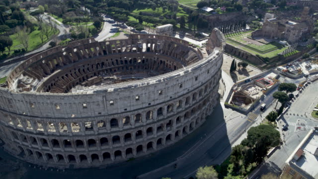 daytime drone flight of a deserted colosseum in rome, italy during the covid 19 shutdown/corona lockdown - roman stock videos & royalty-free footage