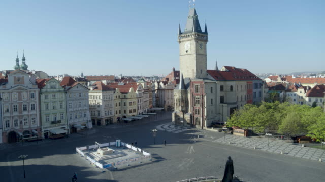 daytime drone flight of a deserted old town square with the prague astronomical clock tower in prague czech republic during the covid 19... - prague old town square stock videos & royalty-free footage