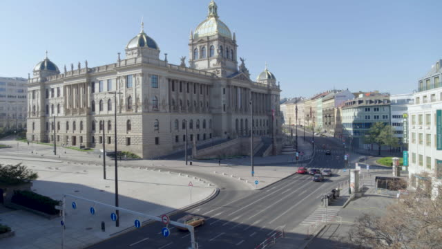 stockvideo's en b-roll-footage met daytime drone flight of a deserted wilsonova street in front of the national museum in prague, czech republic during the covid 19 shutdown/corona... - redactioneel
