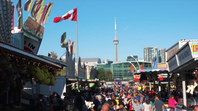 daytime image of the famous and popular event held every year in the canadian city capital of the province of ontario. a crowd walk amid different... - bandiera del canada video stock e b–roll