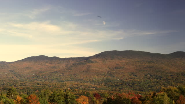 daytime moon over the green mountains in vermont - vermont stock-videos und b-roll-filmmaterial