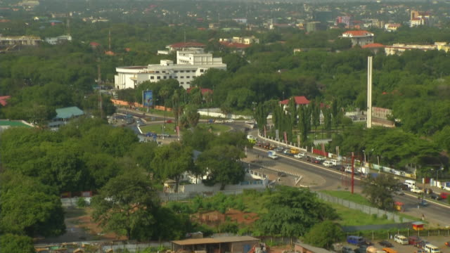 ghana daytime roundabout traffic time lapse - ghana stock videos & royalty-free footage