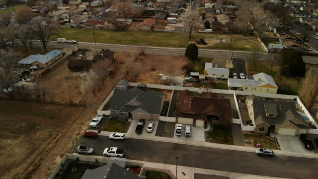 daytime suburb middle and working class western usa real estate market 4k drone video series - rural scene stock videos & royalty-free footage