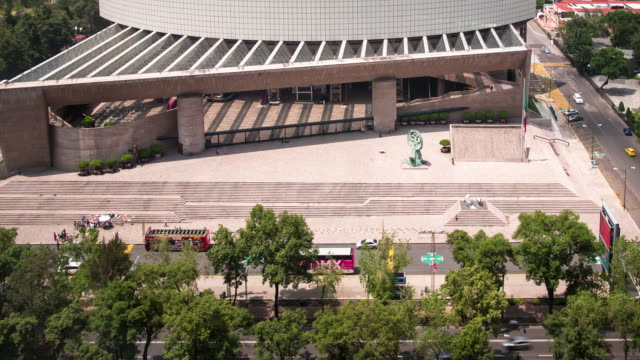 A daytime time lapse of light traffic along the Paseo de la Reforma in Mexico City, with views of the Auditorio Nacional (Spanish: 'National Auditorium').