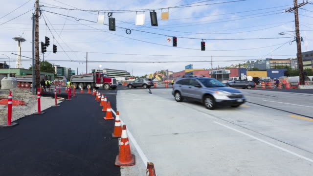 Daytime time lapse of pedestrian and automobile traffic at an intersection under construction