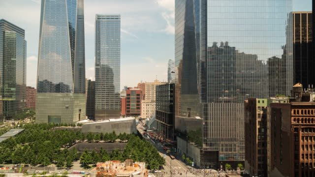a daytime time lapse of the 9/11 memorial park and surroundings in lower manhattan, new york, featuring heavy foot traffic in and around the plaza - filiz stock videos & royalty-free footage