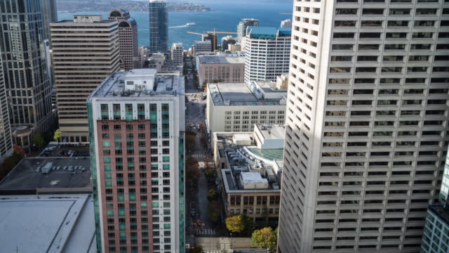 Daytime time lapse of traffic flowing on Pine Street towards Pike Place Market taken as a POV from a high rise building