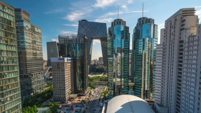 daytime timelapse of beijing china with cctv building - beijing stock videos & royalty-free footage