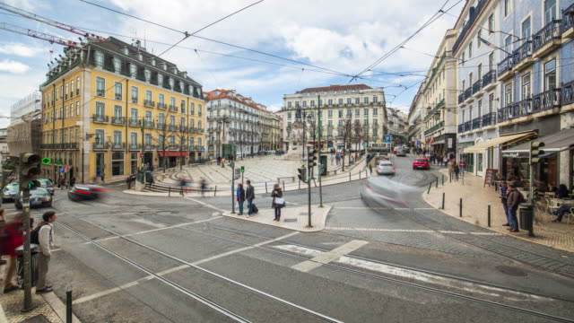 daytime timelapse of the luã­s de camãµes square with car traffic. lisbon, portugal. april, 2017 - lisbon stock videos and b-roll footage