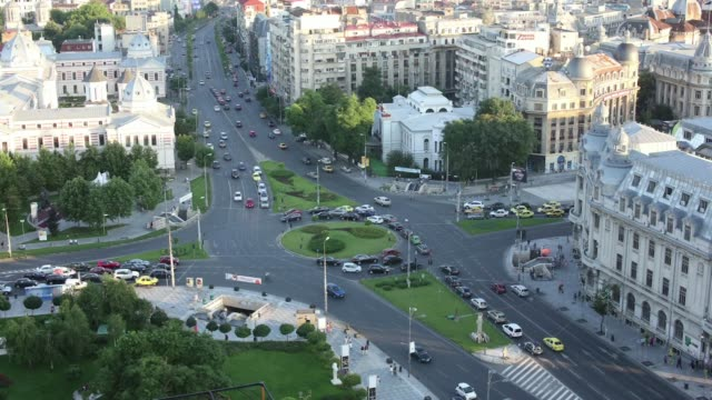 A daytime timelapse sequence shows high angle view traffic driving around the University roundabout in the center of Bucharest Romania on Wednesday...