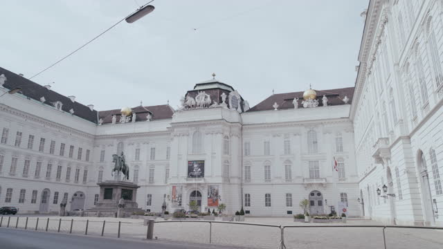 daytime view of a deserted joseph's square at the hofburg with the monument of emperor joseph ii at its centre in vienna, austria during the covid 19... - april stock videos & royalty-free footage